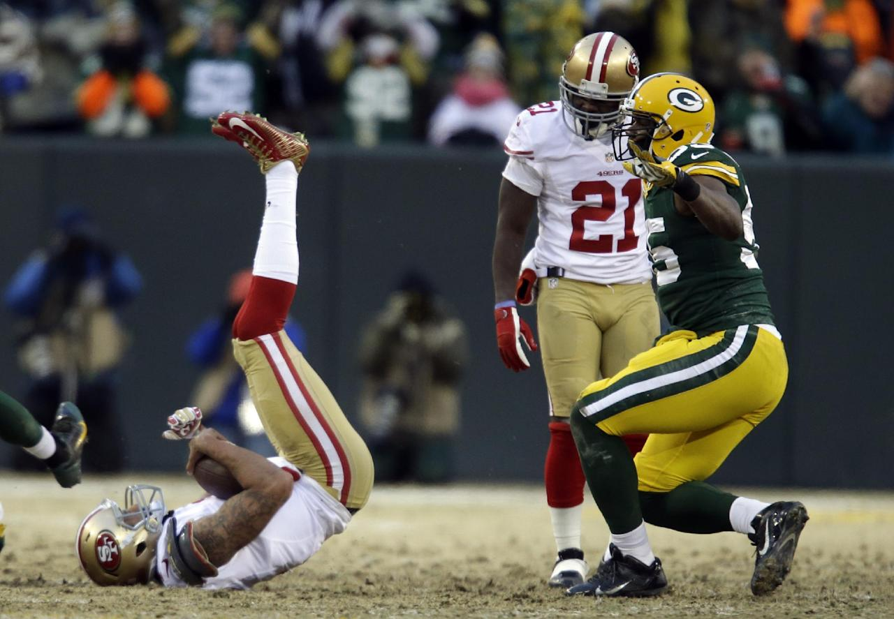 Green Bay Packers outside linebacker Andy Mulumba, right, celebrates after sacking San Francisco 49ers quarterback Colin Kaepernick, left, during the first half of an NFL wild-card playoff football game, Sunday, Jan. 5, 2014, in Green Bay, Wis. (AP Photo/Jeffrey Phelps)