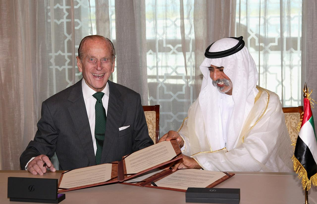 ABU DHABI, UNITED ARAB EMIRATES - NOVEMBER 25:  Prince Philip, Duke of Edinburgh signs a memorandum of understanding between Cambridge University Judge Business School and the University of the UAE for Teaching and Research in the Further Development of Abu Dhabi withSheikh Nahyan bin Mubarak Emirates Palace on November 25, 2010 in Abu Dhabi, United Arab Emirates. Queen Elizabeth II and Prince Philip, Duke of Edinburgh are in Abu Dhabi on a State Visit to the Middle East. The Royal couple will spend two days in Abu Dhabi and three days in Oman.  (Photo by Chris Jackson/Getty Images)