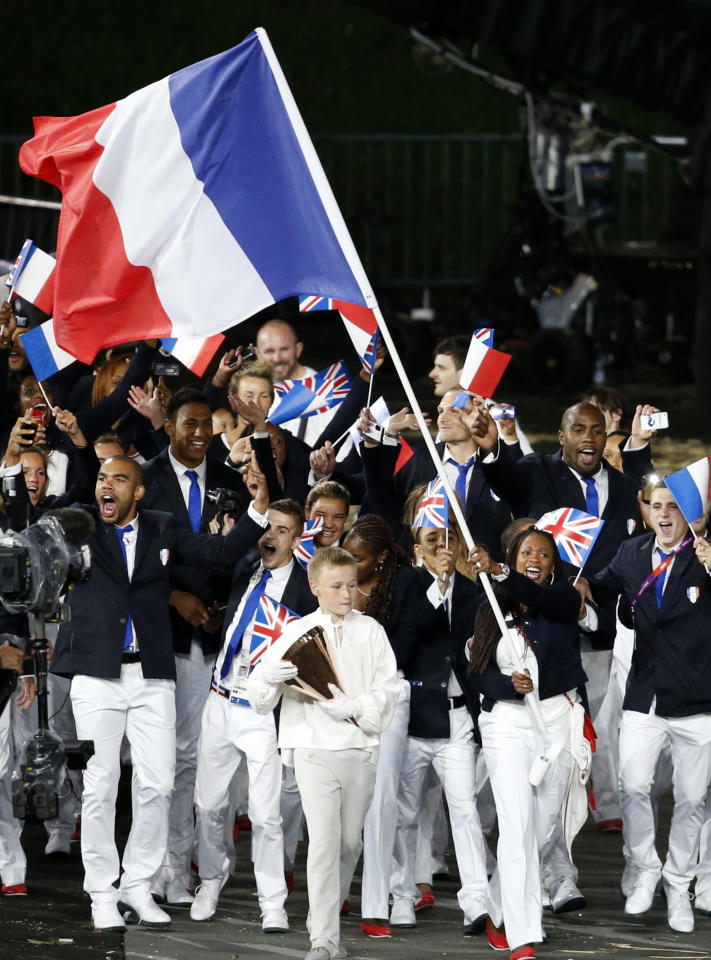 France's Laura Flessel-Colovic carries the flag during the Opening Ceremony at the 2012 Summer Olympics, Friday, July 27, 2012, in London. (AP Photo/Jae C. Hong)