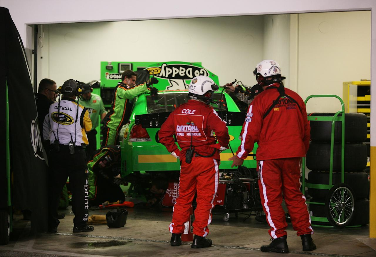 DAYTONA BEACH, FL - FEBRUARY 27:  Crew members work on the #10 GoDaddy.com Chevrolet driven by Danica Patrick in the garage after being involved in an on track incident during the NASCAR Sprint Cup Series Daytona 500 at Daytona International Speedway on February 27, 2012 in Daytona Beach, Florida.  (Photo by Jerry Markland/Getty Images for NASCAR)