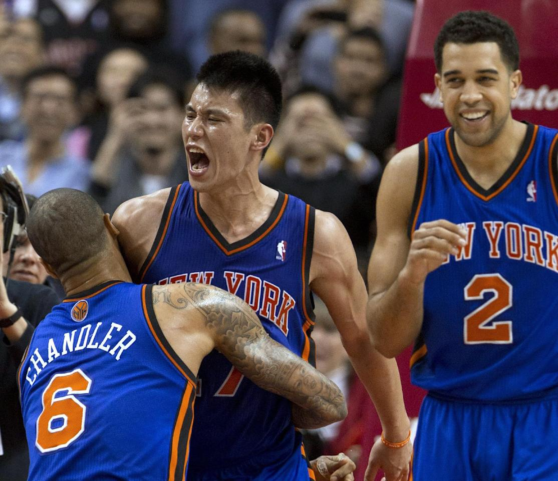 New York Knicks guard Jeremy Lin (17) celebrates with teammates Tyson Chandler and Landry Fields (2) after his game-winning 3-pointer against the Toronto Raptors in an NBA basketball game in Toronto on Tuesday, Feb. 14, 2012. (AP Photo/The Canadian Press, Frank Gunn)