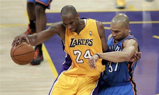 Los Angeles Lakers' Kobe Bryant, left, is pressured by Oklahoma City Thunder's Derek Fisher during the second half in Game 3 of an NBA basketball playoffs Western Conference semifinal in Los Angeles, Friday, May 18, 2012. The Lakers won 99-96. (AP Photo/Jae C. Hong)