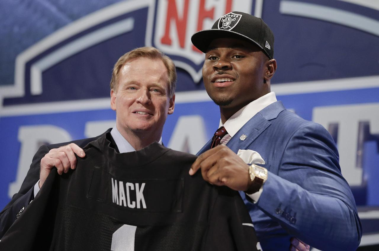 Buffalo linebacker Khalil Mack, right, poses for photos with NFL commissioner Roger Goodell after being selected by the Oakland Raiders as the fifth pick in the first round of the 2014 NFL Draft, Thursday, May 8, 2014, in New York. (AP Photo/Craig Ruttle)