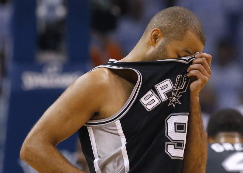 San Antonio Spurs guard Tony Parker wipes his brow between plays against the Oklahoma City Thunder in the first half of Game 6 of the Western Conference finals NBA basketball playoff series, in Oklahoma City, Saturday, May 31, 2014