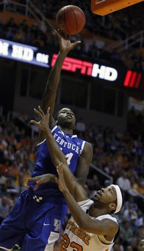 Kentucky's Michael Kidd-Gilchrist (14) shoots over Tennessee's Cameron Tatum (23) in the second half of an NCAA college basketball game on Saturday, Jan. 14, 2012, in Knoxville, Tenn. Kentucky won 65-62. (AP Photo/Wade Payne)