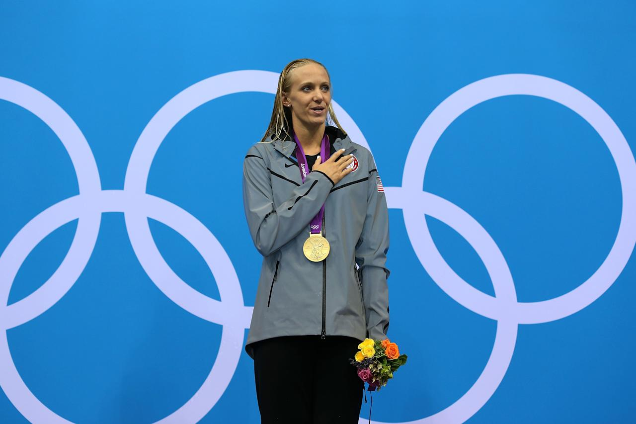 LONDON, ENGLAND - JULY 29:  gold medallist Dana Vollmer of the United States poses on the podium during the medal ceremony after setting a new world record time of 55.98 seconds in the Women's 100m Butterfly final on Day 2 of the London 2012 Olympic Games at the Aquatics Centre on July 29, 2012 in London, England.  (Photo by Clive Rose/Getty Images)