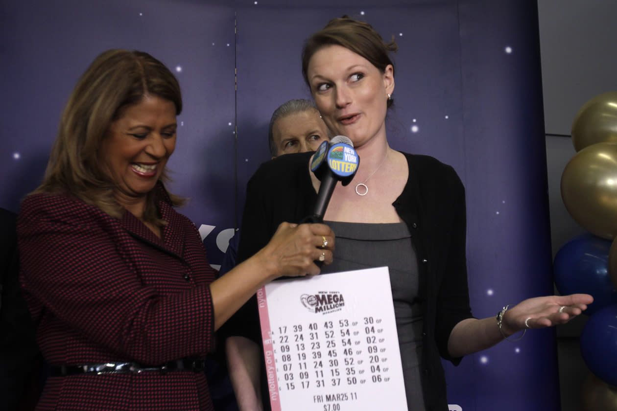 <b>$319 million</b><br><br>Gabrielle Mahar, right, who shared in the $319 million Mega Millions lottery win, talks with New York Lottery's Yolanda Vega during a news conference in Schenectady, N.Y., Thursday, March 31, 2011.