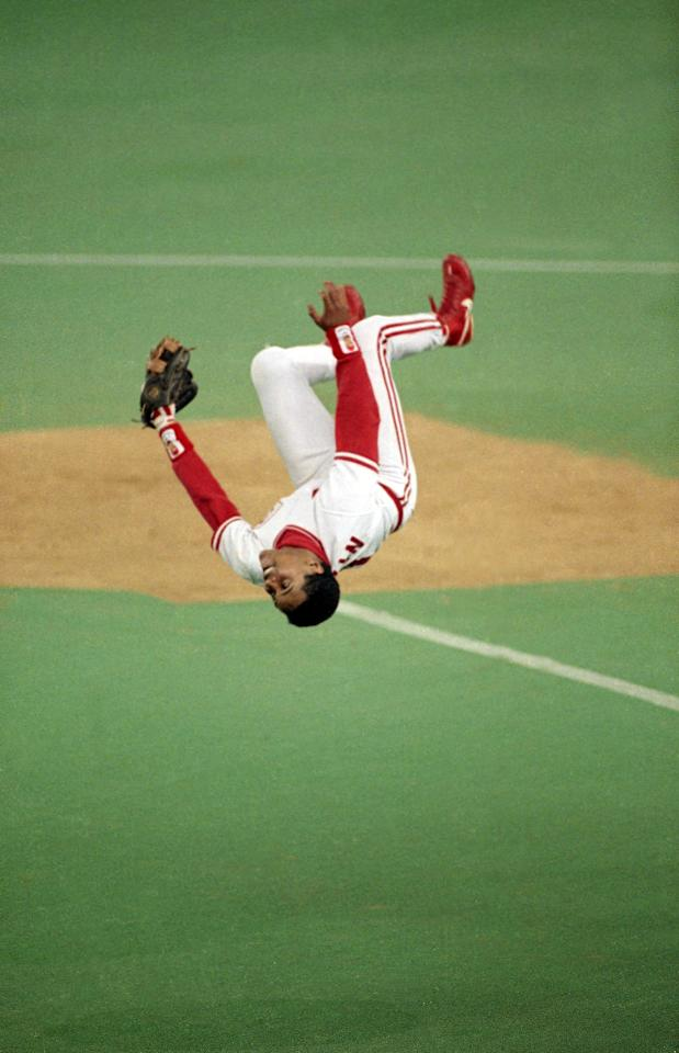 FILE - In this Oct. 13, 1990 file photo, Cincinnati Reds shortstop Barry Larkin does a flip after the Reds defeated the Pittsburgh Pirates 2-1 at Riverfront Stadium, to win the NLCS, in Cincinnati, Oh. Larkin has been elected to baseball's Hall of Fame. The shortstop received 86 percent of the vote in balloting announced Monday, Jan. 9, 2012 by the Baseball Writers' Association of America. (AP Photo/Mark Duncan, File)