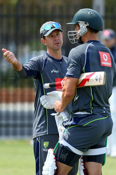 Ricky Ponting talks with Mitchell Johnson during an Australian training session at WACA on November 29, 2012 in Perth, Australia.  (Photo by Paul Kane/Getty Images)