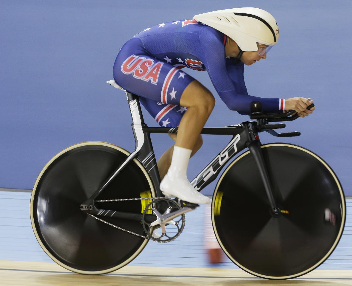 Sarah Hammer of The United States competes in the track cycling women's omnium individual pursuit, at the 2012 Summer Olympics, Tuesday, Aug. 7, 2012, in London. (AP Photo/Sergey Ponomarev)