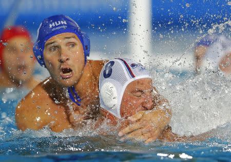 Hungary's Szivos fights for the ball with Serbia's Aleksic during their men's European Water Polo Championship match in Budapest