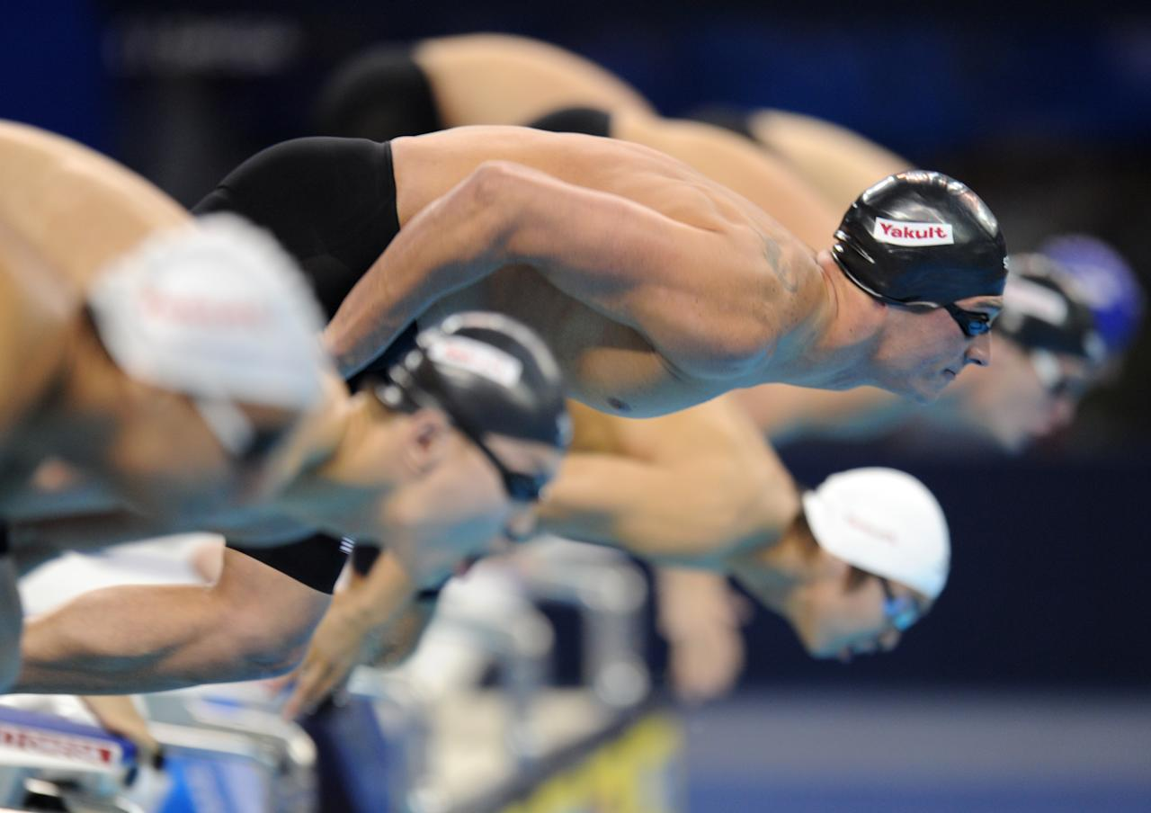 US swimmer Ryan Lochte (c) takes the start of the final of the men's 400-metre individual medley swimming event in the FINA World Championships at the indoor stadium of the Oriental Sports Center in Shanghai on July 31, 2011. Lochte won the race and claimed his fifth gold of the championships in 4min 7.13sec.   AFP PHOTO / FRANCOIS XAVIER MARIT (Photo credit should read FRANCOIS XAVIER MARIT/AFP/Getty Images)