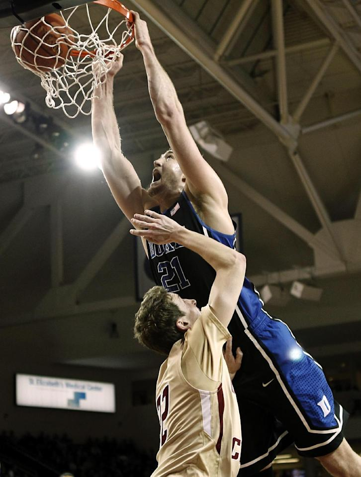 Duke's Miles Plumlee dunks over Boston College's John Cahill during the first half of an NCAA college basketball game in Boston, Sunday, Feb. 19, 2012. (AP Photo/Winslow Townson)