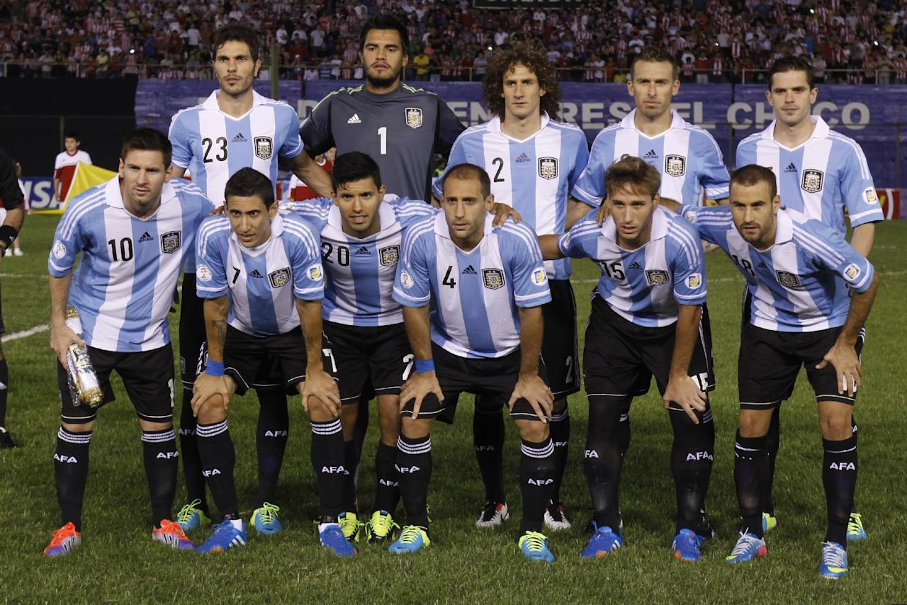 FILE- In this Sept. 10, 2013 file photo, Argentina soccer team poses prior to the start the World Cup qualifying soccer match between Argentina and Paraguay in Asuncion, Paraguay. Background from left: Jose Basanta, Sergio Romero, Fabricio Coloccini, Hugo Campagnaro and Fernando Gago. Foreground from left: Lionel Messi, Angel Di Maria, Sergio Aguero, Pablo Zabaleta, Lucas Biglia and Rodrigo Palacio. (AP Photo/Cesar Olmedo, File)