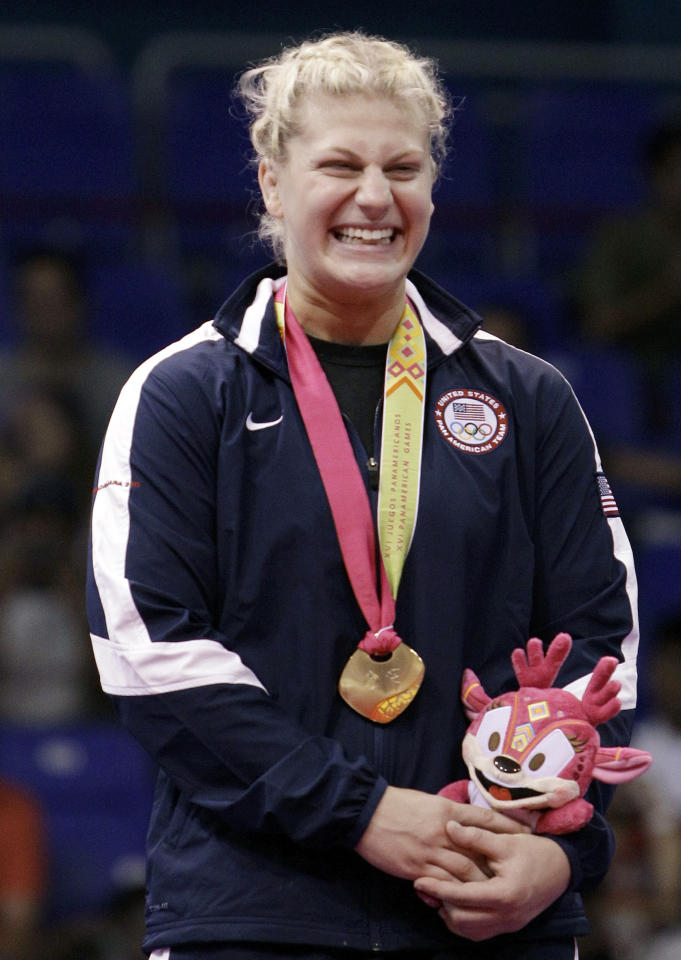 Gold medalist Kayla Harrison, of the United States, smiles in the podium of the women's -78kg of the judo competition at the Pan American Games in Guadalajara, Mexico, Thursday Oct. 27, 2011. (AP Photo/Javier Galeano)