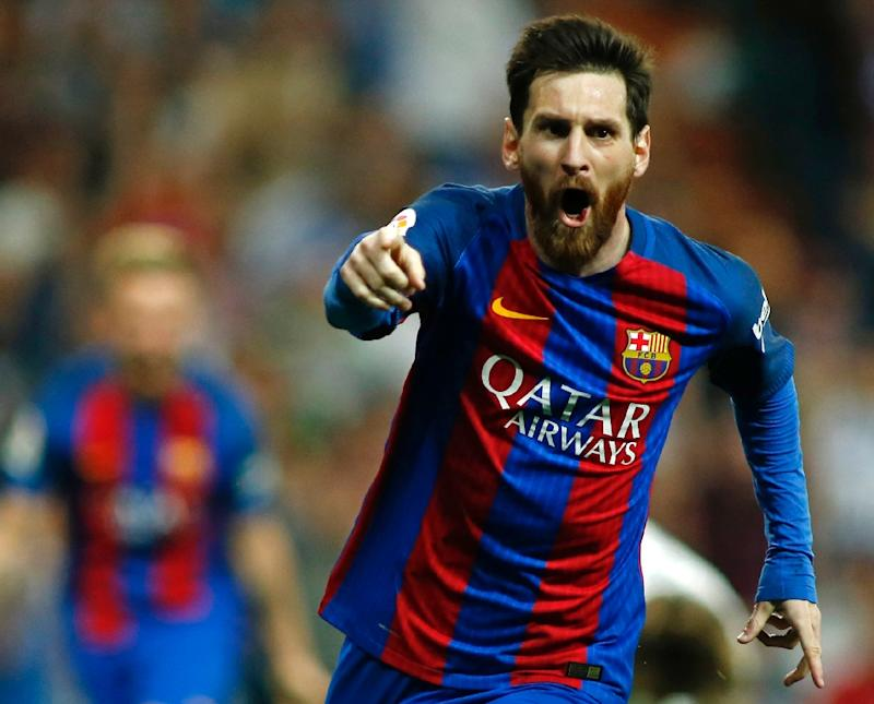 Messi sinks Real Madrid to keep Barcelona in La Liga title race