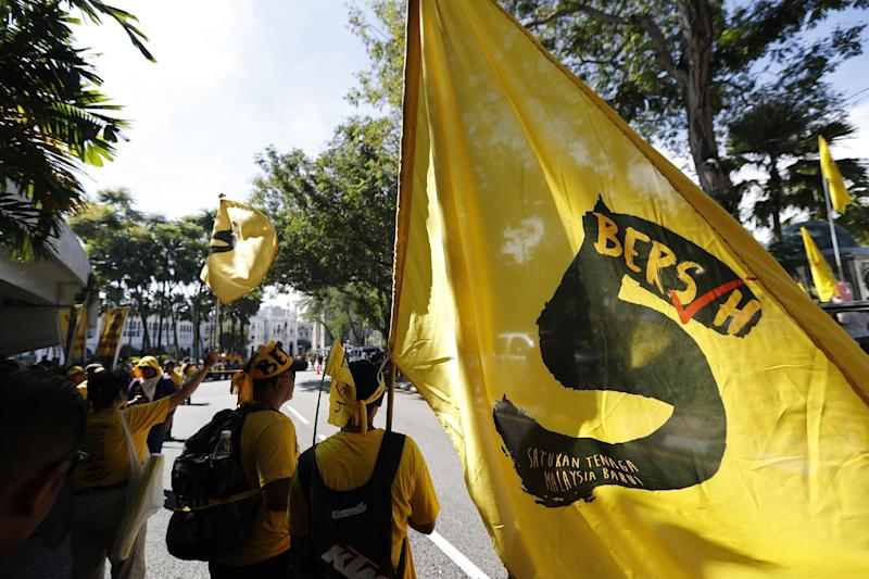 Malaysian reform group raided ahead of rally, 2 held