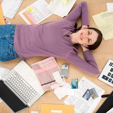 Woman-lying-on-floor-with-office-supplies_web