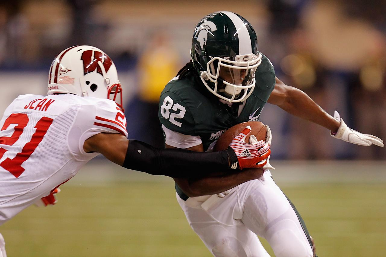 INDIANAPOLIS, IN - DECEMBER 03:  Keshawn Martin #82 of the Michigan State Spartans runs for yards after the catch against Peniel Jean #21 of the Wisconsin Badgers during the Big 10 Conference Championship Game at Lucas Oil Stadium on December 3, 2011 in Indianapolis, Indiana.  (Photo by Gregory Shamus/Getty Images)