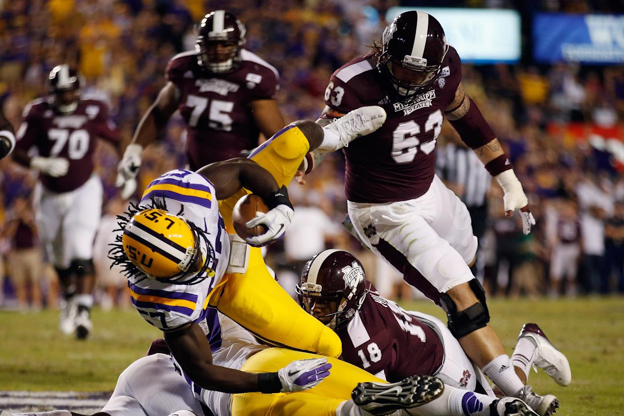 BATON ROUGE, LA - NOVEMBER 10:  Cody Townsend #57 of the LSU Tigers recovers a fumble during the game against the Mississippi State Bulldogs at Tiger Stadium on November 10, 2012 in Baton Rouge, Louisiana.  (Photo by Chris Graythen/Getty Images)