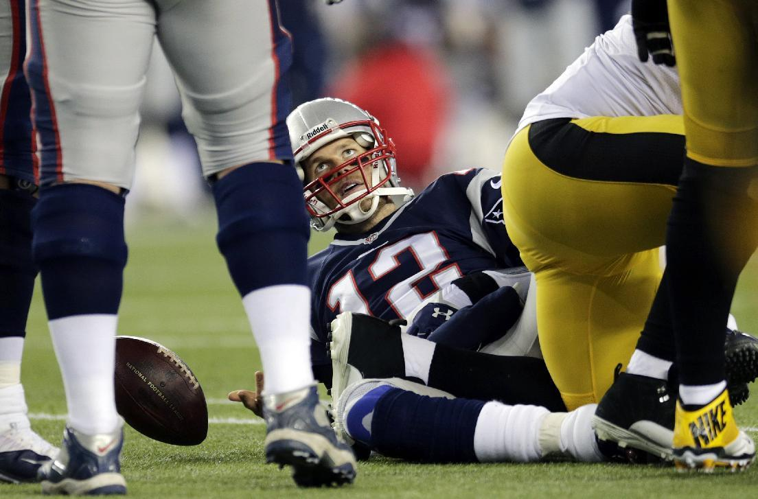 New England Patriots quarterback Tom Brady looks up from the turf after being sacked in the second quarter of an NFL football game against the Pittsburgh Steelers, Sunday, Nov. 3, 2013, in Foxborough, Mass. (AP Photo/Charles Krupa)
