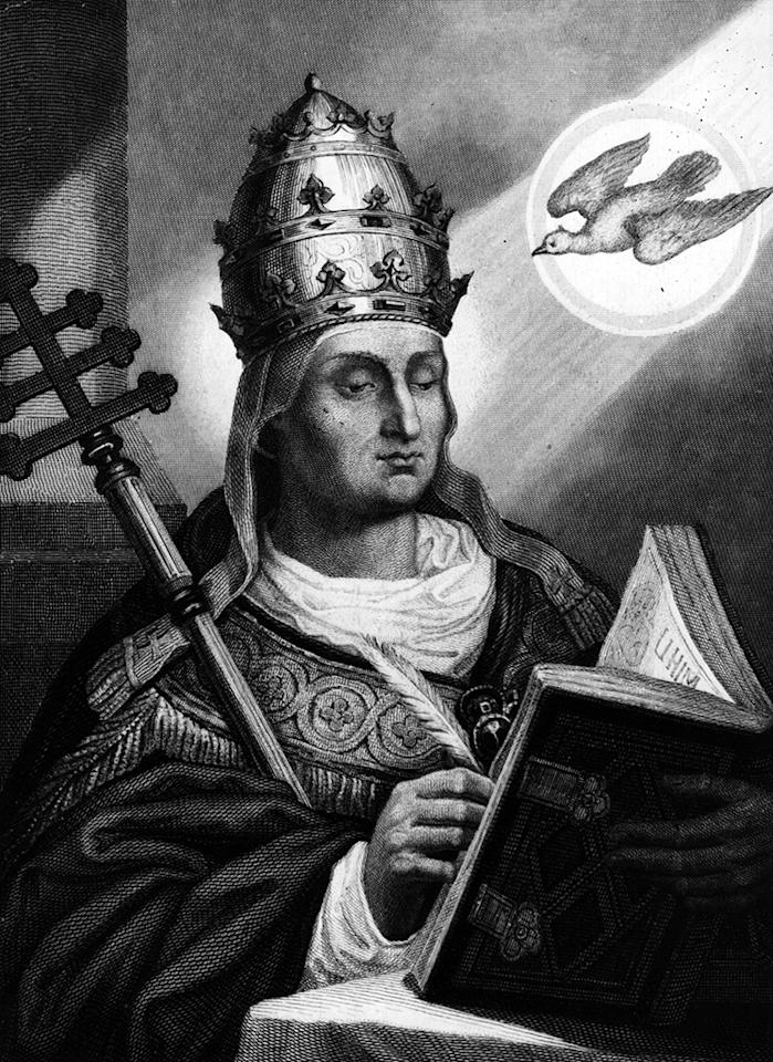 Circa 590 AD, Gregory the Great, Pope Gregory I (540 - 604). Pope and saint, holding a symbol of his office and wearing the papal crown . A dove is flying over his shoulder in a shaft of light. He introduced Gregorian chant to the liturgy. (Photo by Hulton Archive/Getty Images)