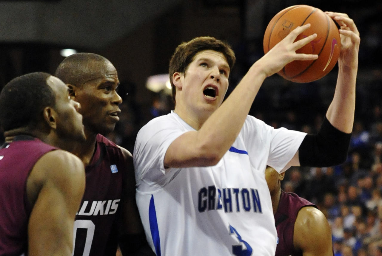 Creighton's Doug McDermott (3) drives past Southern Illinois' Dantiel Daniels, left, and Mamadou Seck (0) during an NCAA college basketball game, Sunday, Jan. 15, 2012, in Omaha, Neb. Creighton won 90-71. (AP Photo/Dave Weaver)