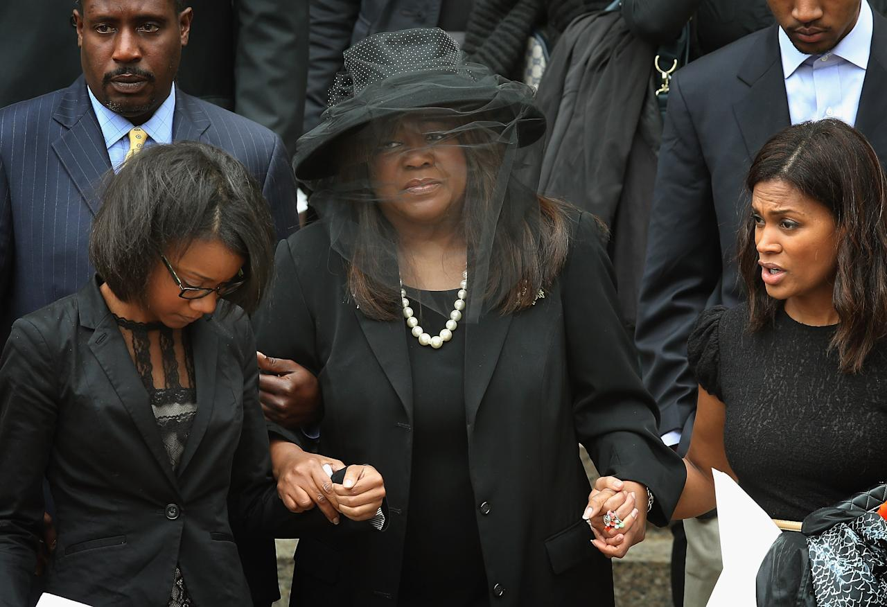 CHICAGO, IL - APRIL 08:  Chaz Ebert (C), the wife of film critic Roger Ebert, leaves Holy Name Cathedral following a funeral service for her husband April 8, 2013 in Chicago, Illinois. Ebert died April 4, at the age of 70, after a long battle with cancer.  (Photo by Scott Olson/Getty Images)