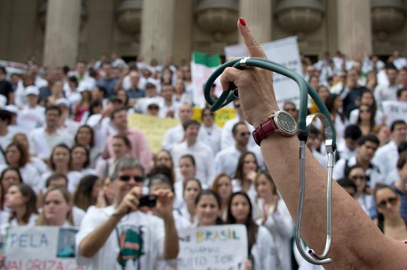 Medical and health workers protest against the working conditions in the public hospitals in Rio de Janeiro, Brazil, on July 3, 2013