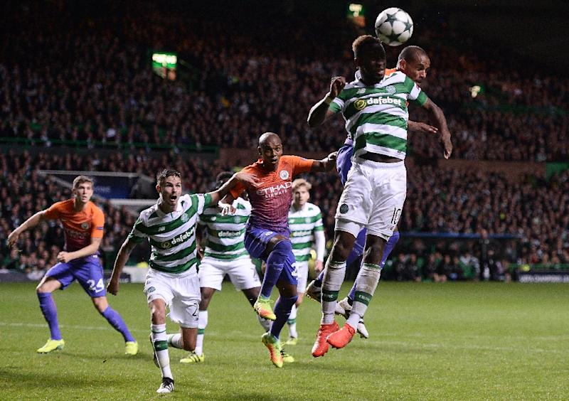 Manchester City's Brazilian midfielder Fernando (R) vies in the air with Celtic's French striker Moussa Dembele during the UEFA Champions League match in Glasgow, Scotland on September 28, 2016
