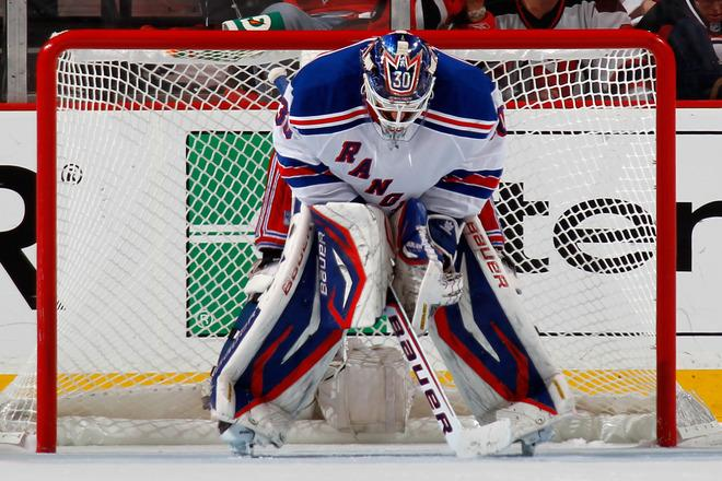 NEWARK, NJ - MAY 25:  Henrik Lundqvist #30 of the New York Rangers looks on from goal against the New Jersey Devils in Game Six of the Eastern Conference Final during the 2012 NHL Stanley Cup Playoffs at the Prudential Center on May 25, 2012 in Newark, New Jersey.  (Photo by Bruce Bennett/Getty Images)