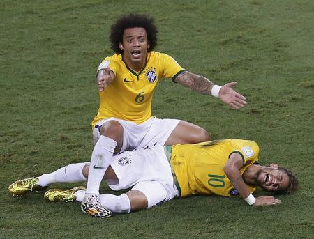 Brazil's Marcelo gestures over his injured teammate Neymar during their 2014 World Cup quarter-finals at the Castelao arena in Fortaleza