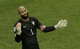 Tim Howard gestures to his teammates after making a save during the U.S. team's loss to Belgium. (AP)
