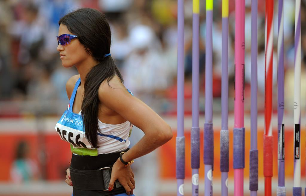 Leryn Franco of Paraguay waits her turn in the women's javelin throw qualifiyer during the athletics competitions in the National Stadium at the Beijing 2008 Olympics in Beijing, Tuesday, Aug. 19, 2008. (AP Photo/Thomas Kienzle)