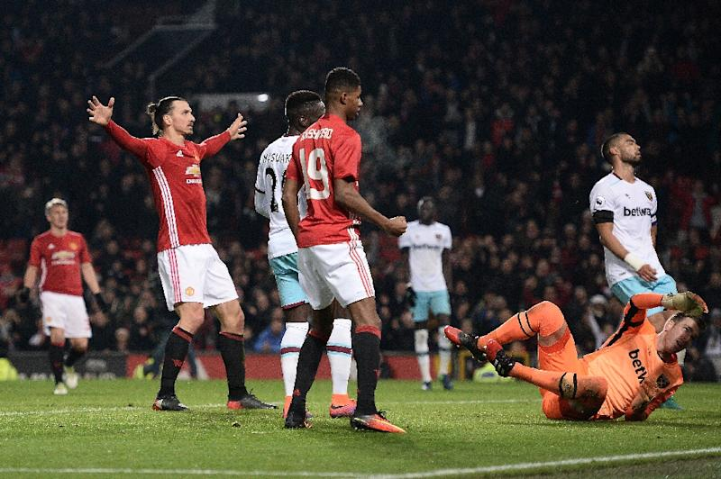 Manchester United's Swedish striker Zlatan Ibrahimovic (L) celebrates scoring histeam's fourth goal against West Ham United at Old Trafford in Manchester, north west England, on November 30, 2016