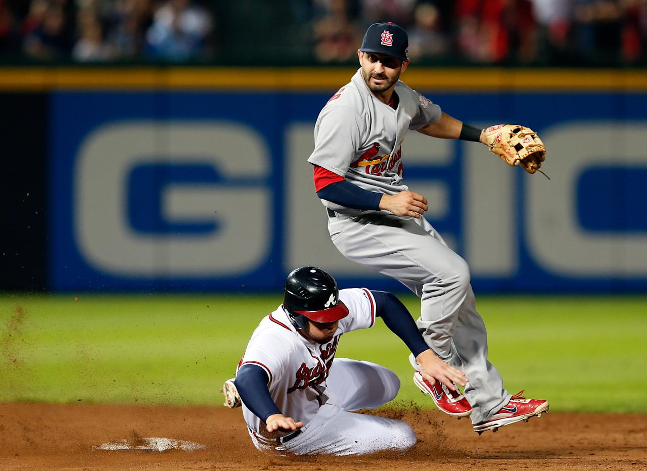 ATLANTA, GA - OCTOBER 05:  Daniel Descalso #33 of the St. Louis Cardinals attempts to turn a double play as Freddie Freeman #5 of the Atlanta Braves slides into second base as Dan Uggla #26 is safe at first in the eighth inning during the National League Wild Card playoff game at Turner Field on October 5, 2012 in Atlanta, Georgia.  (Photo by Kevin C. Cox/Getty Images)