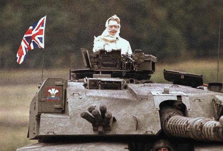 "FILE - In this Sept. 17, 1986 file photo, British Prime Minister Margaret Thatcher stands in a British tank during a visit to British forces in Fallingbostel, some 120km (70 miles) south of Hamburg, Germany. Thatcher's former spokesman, Tim Bell, said the former prime minister, known to both friends and foes as ""The Iron Lady,"" died of a stroke Monday morning, April 8, 2013. She was 87. (AP Photo/Jockel Fink, File)"