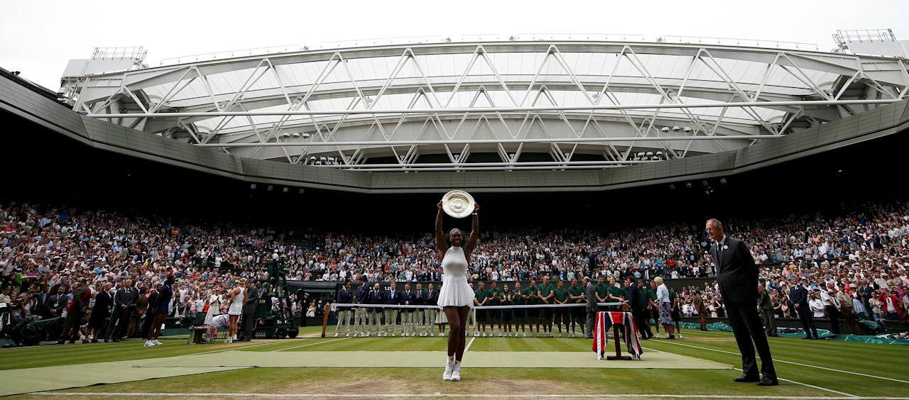 Britain Tennis - Wimbledon - All England Lawn Tennis & Croquet Club, Wimbledon, England - 9/7/16 USA's Serena Williams celebrates winning her womens singles final match against Germany's Angelique Kerber with the trophy REUTERS/Andrew Couldridge     TPX IMAGES OF THE DAY
