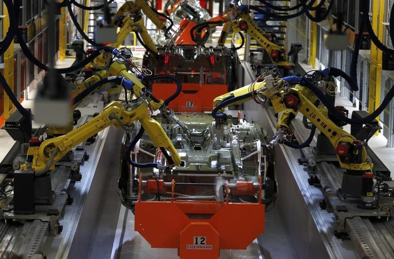 Robotic Arms work on the underside of the 2015 Chrysler 200 vehicle at the Sterling Heights Assembly Plant in Michigan