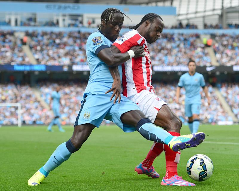 Stoke City's Victor Moses (R) and Manchester City's Bacary Sagna during their Premier League match at Etihad Stadium on August 30, 2014