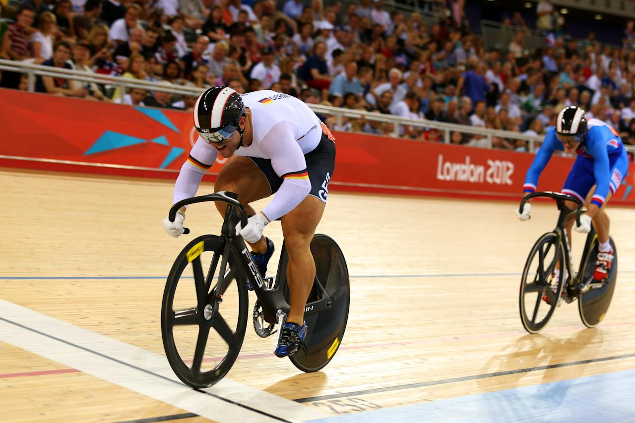 LONDON, ENGLAND - AUGUST 04:  Robert Forstemann of Germany crosses the line to win the Men's Sprint Track Cycling 1/8 Final Repechages ahead of Pavel Kelemen of Czech Republic (R) on Day 8 of the London 2012 Olympic Games at Velodrome on August 4, 2012 in London, England. (Photo by Bryn Lennon/Getty Images)