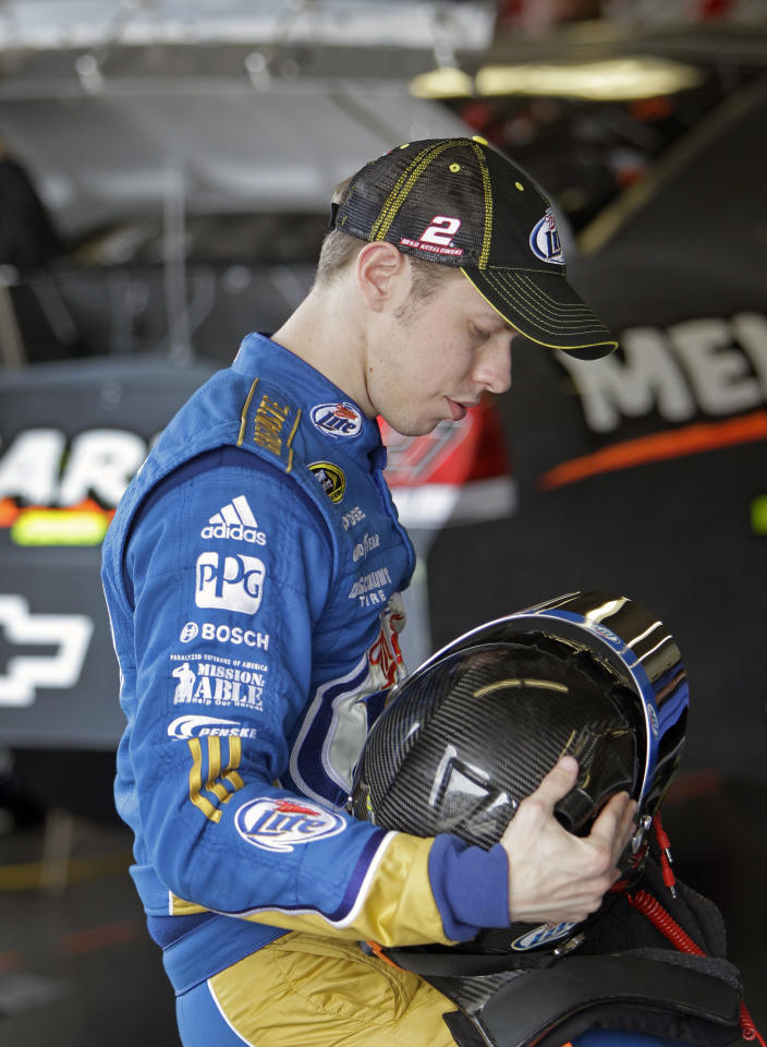 Driver Brad Keselowski adjusts his helmet before going out on the track during NASCAR auto racing testing at the Daytona International Speedway, Thursday, Jan. 12, 2012, in Daytona Beach, Fla. (AP Photo/John Raoux)