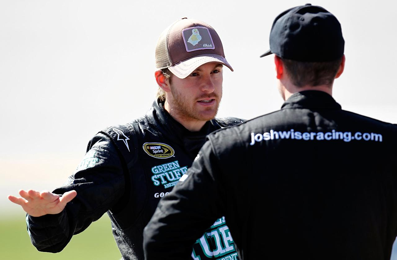 TALLADEGA, AL - OCTOBER 22:  Scott Speed, driver of the #46 Red Line Oil Ford, speaks with Josh Wise, driver of the #37 Bradley University Ford, during qualifying for the NASCAR Sprint Cup Series Good Sam Club 500 at Talladega Superspeedway on October 22, 2011 in Talladega, Alabama.  (Photo by Jeff Zelevansky/Getty Images for NASCAR)