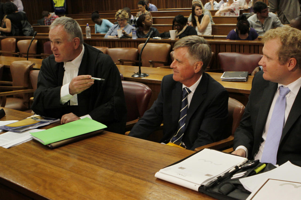 The defense team for Oscar Pistorius, led by Barry Roux, left, prepare for an appeasl against bail conditions in the Pretoria, South Africa high court, Thursday, March 28, 2013. Pistorius is charged with the shooting death of his girlfriend Reeva Steenkamp last month. (AP Photo/Denis Farrell)