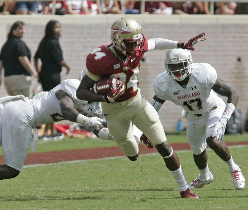 Florida State's Isaiah Jones tries to pick up extra yards after a reception against Maryland in the third quarter of an NCAA college football game on Saturday, Oct. 5, 2013, in Tallahassee, Fla. Florida State 63-0