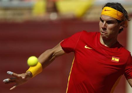 Nadal of Spain looks at ball before returning shot during his Davis Cup World Group semi-final against Tsonga of France in Cordoba