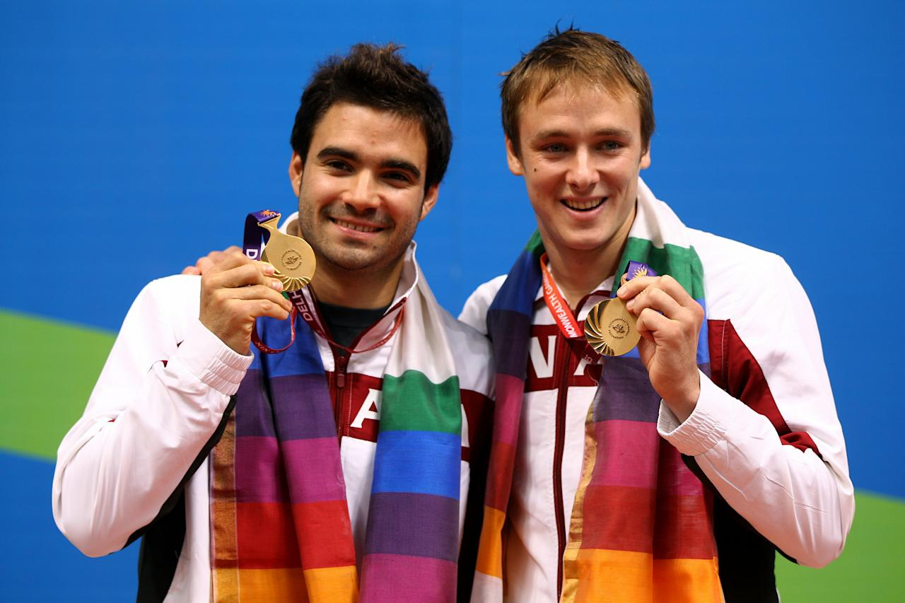 DELHI, INDIA - OCTOBER 12:  Alexandre Despatie and Reuben Ross of Canada pose with the gold medals won in the Men's 3m Synchro Springboard Final at Dr. S.P. Mukherjee Aquatics Complex on day nine of the Delhi 2010 Commonwealth Games on October 12, 2010 in Delhi, India.  (Photo by Feng Li/Getty Images)