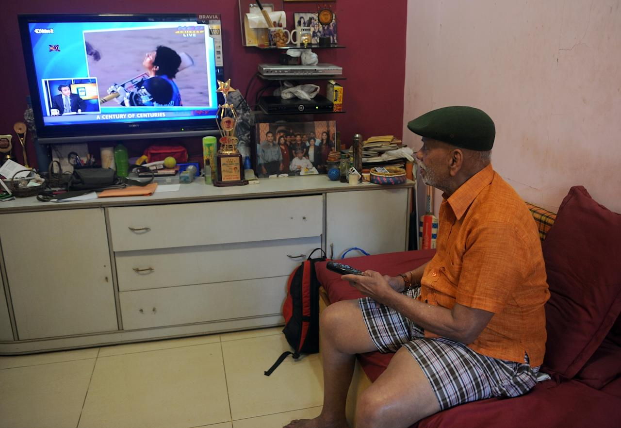 Ramakant Achrekar, cricket coach of Sachin Tendulkar, watches Tendulkar scoring his 100th century, on a television set at his house in Mumbai on March 16, 2012. India's Sachin Tendulkar became the first batsman in history to score 100 international centuries, adding another milestone in his record-breaking career. AFP PHOTO/Punit PARANJPE (Photo credit should read PUNIT PARANJPE/AFP/Getty Images)