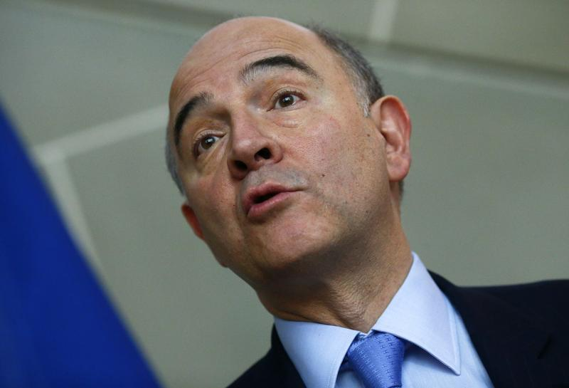 French Finance Minister Moscovici speaks to media after an official meeting with Swiss Finance Minister Widmer-Schlumpf in Bern