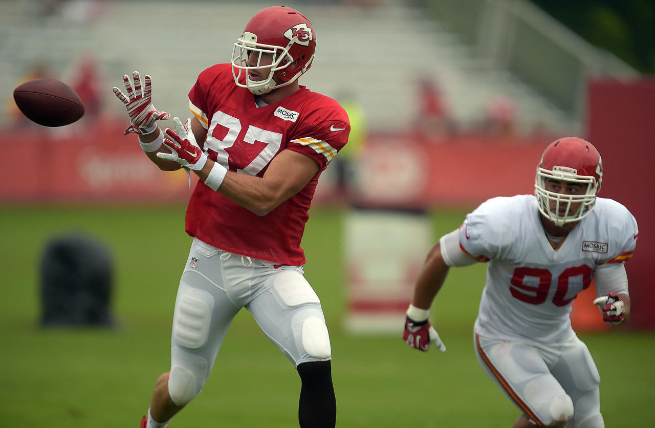 Kansas City Chiefs tight end Travis Kelce (87) looks to make a reception during practice Sunday morning, Aug. 10, 2014, on the Missouri Western State University campus in St. Joseph. Mo. (AP Photo/St. Joseph News-Press, Todd Weddle)